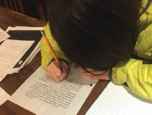 Student writes in journal