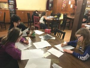 Groups of students write their maritime stories